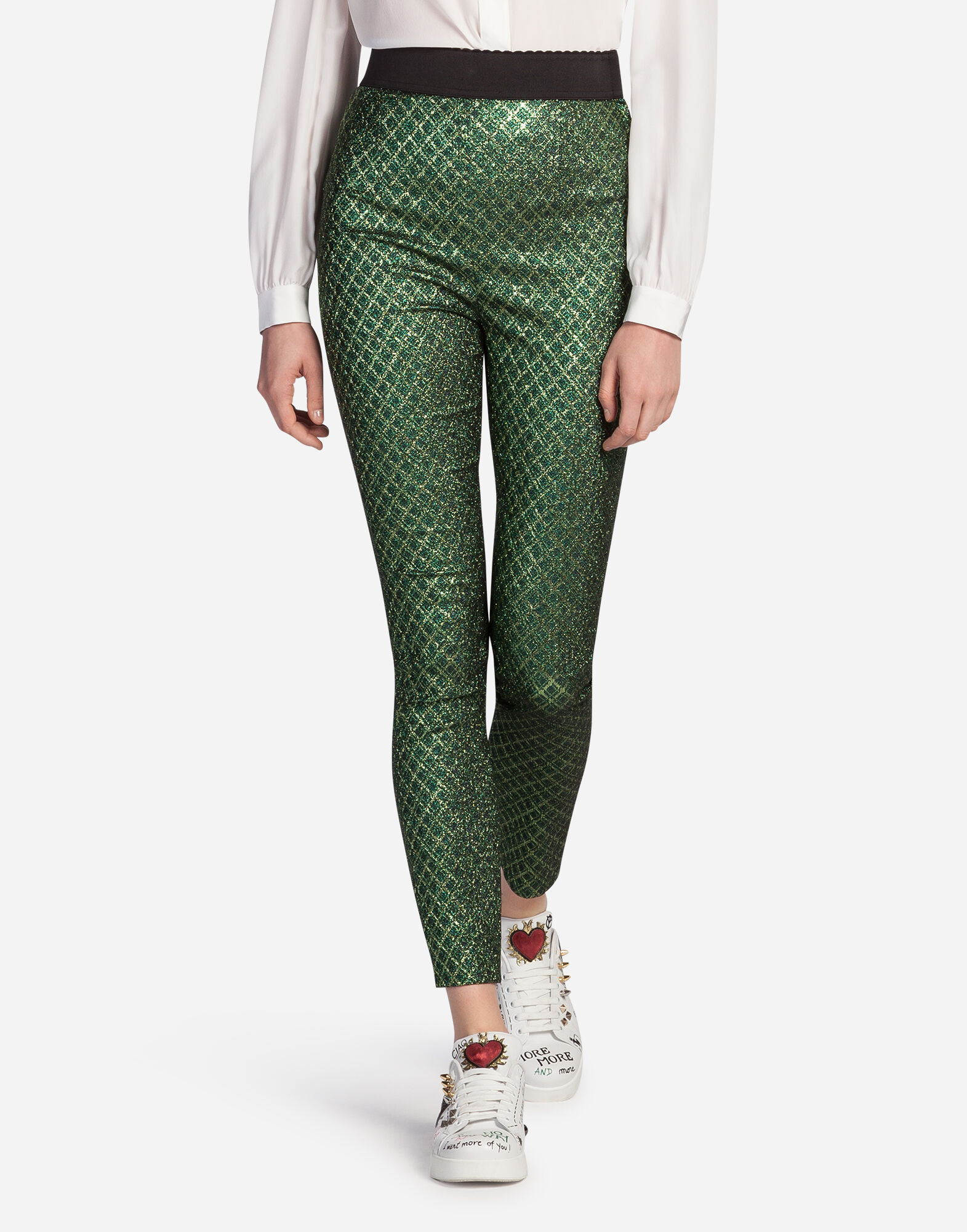 With a desirable textural serpentine pattern, these soft jacquard pants provide a neutral start to a highly chic look. Designer-styled with side zip, back elastic waistband, back patch pockets and petite side slits.