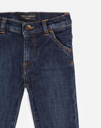 STRETCH JEANS WITH EMBROIDERED DETAIL