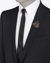 STRETCH WOOL SUIT WITH APPLIQUÉS