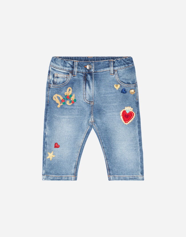 JEANS WITH EMBROIDERED PATCHES