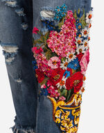 JEANS EMBELLISHED BY EMBROIDERY