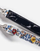 PRINTED PATENT LEATHER STRAP WITH APPLIQUÉ DETAILS