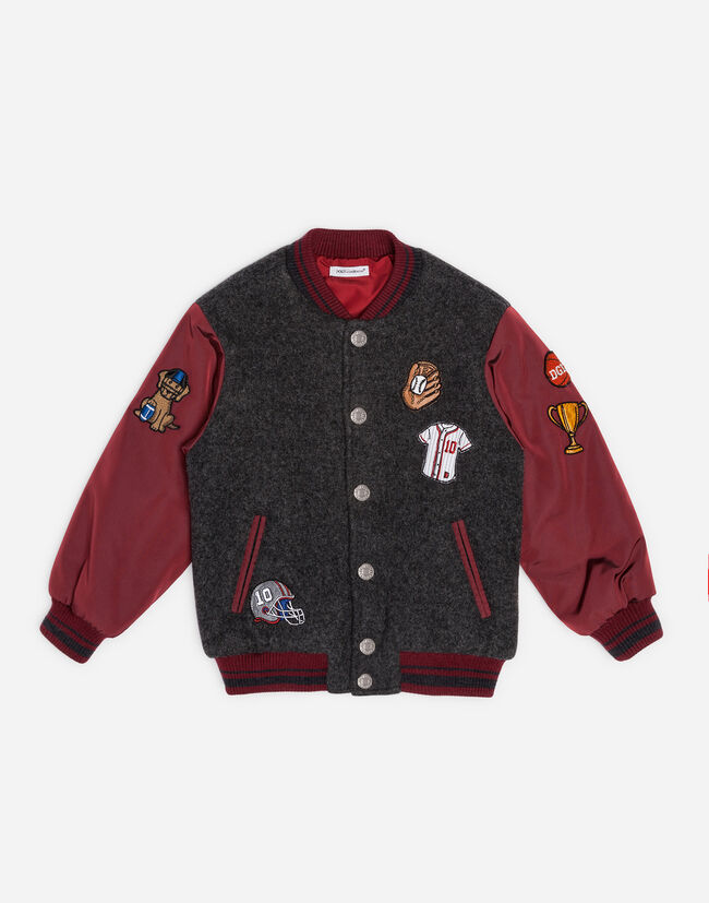 BOMBER JACKET IN MIXED MATERIALS WITH PATCHES