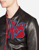 LEATHER BOMBER JACKET WITH PATCHES